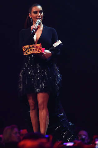 Kim Kardashian presents the award for Best Song onstage at the MTV EMA's 2012 at Festhalle Frankfurt on November 11, 2012 in Frankfurt am Main, Germany. Photo: Andreas Rentz, Getty Images For MTV / 2012 Getty Images