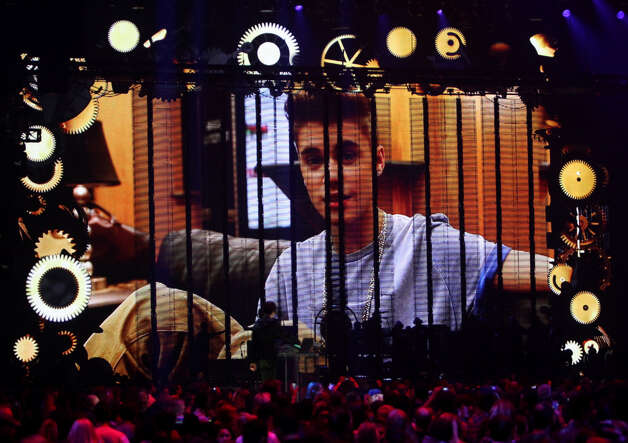 Canadian singer-songwriter Justin Bieber is seen on the screen during the 2012 MTV European Music Awards (EMA) at the Festhalle in Frankfurt am Main, central Germany on November 11, 2012. Photo: DANIEL ROLAND, AFP/Getty Images / AFP