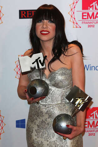 Carly Rae Jepsen poses with her awards for the Best Song, 'Call me, maybe' and Best Push backstage in the photo room the MTV EMA's 2012 at Festhalle Frankfurt on November 11, 2012 in Frankfurt am Main, Germany. Photo: Tim Whitby, Getty Images For MTV / 2012 Getty Images