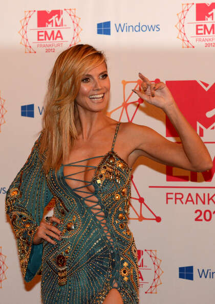 German supermodel and show host Heidi Klum poses for photographers on the red carpet for the 2012 MT
