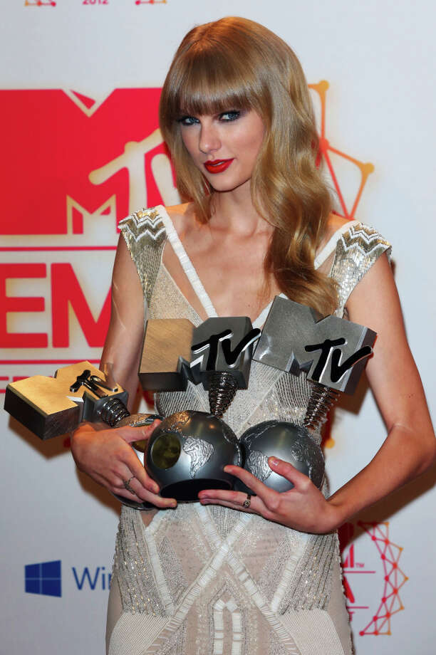 Singer Taylor Swift poses backstage in the photo room with her awards for Best Female, Best Live and Best Look at the MTV EMA's 2012 at Festhalle Frankfurt on November 11, 2012 in Frankfurt am Main, Germany. Photo: Tim Whitby, Getty Images For MTV / 2012 Getty Images