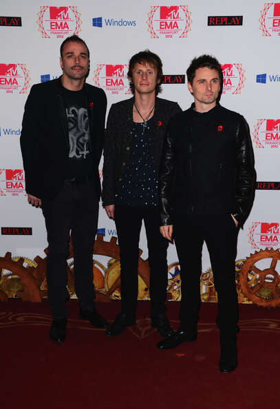 (L-R), Chris Wolstenholme, Dominic Howard and Matthew Bellamy of Muse attend the MTV EMA's 2012 at F