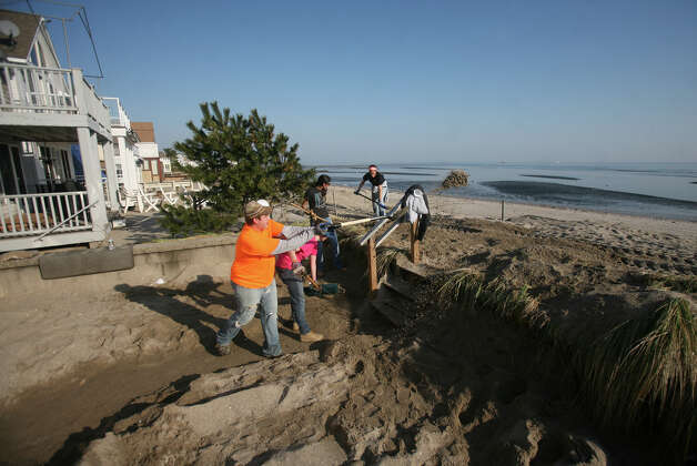 Volunteer beach clean up continues in the wake of Hurricane Sandy on Fairfield Beach Road in Fairfield on Sunday, November 11, 2012. Photo: Brian A. Pounds / Connecticut Post