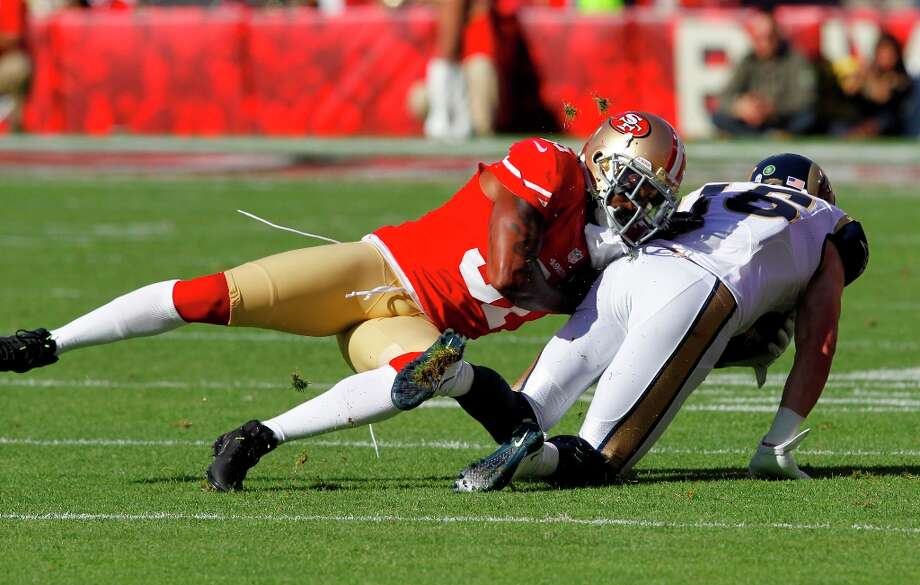 Safety Donte Whitner (31) takes down St. Louis Rams wide receiver Danny Amendola (16) during the first half of the San Francisco 49ers game against the St. Louis Rams at Candlestick Park in San Francisco, Calif., on Sunday November 11, 2012. Photo: Brant Ward, The Chronicle / ONLINE_YES