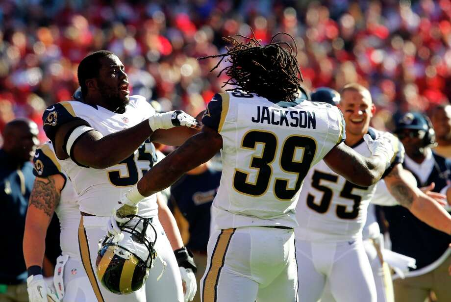 St. Louis Rams running back Steven Jackson (39) celebrates his touchdown with teammates St. Louis Rams defensive end William Hayes (95) and St. Louis Rams linebacker James Laurinaitis (55) during the San Francisco 49ers game against the St. Louis Rams at Candlestick Park in San Francisco, Calif., on Sunday November 11, 2012. Photo: Brant Ward, The Chronicle / ONLINE_YES