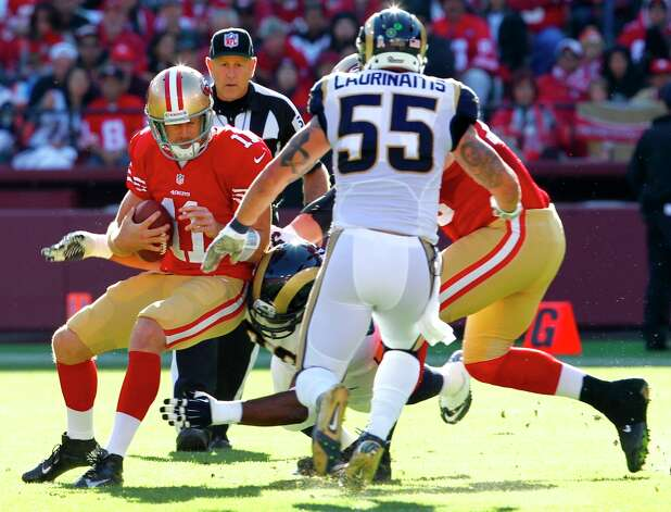 Quarterback Alex Smith (11) gets sacked by St. Louis Rams defensive tackle Michael Brockers (90) in the second quarter of the San Francisco 49ers game against the St. Louis Rams at Candlestick Park in San Francisco, Calif., on Sunday November 11, 2012. Photo: Brant Ward, The Chronicle / ONLINE_YES