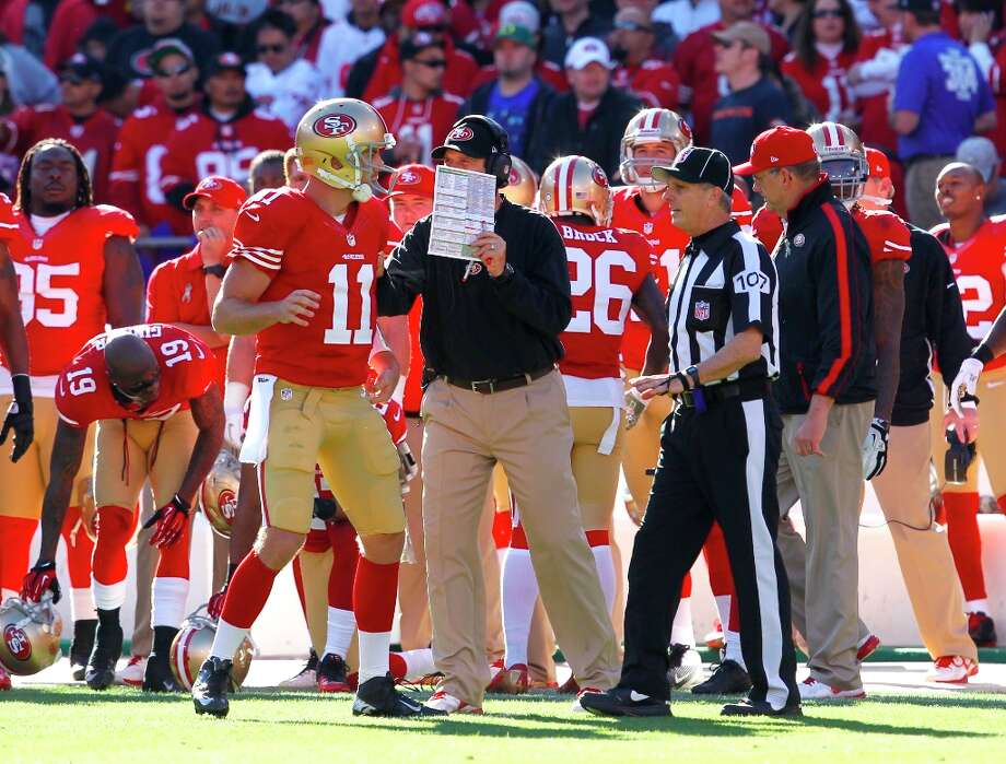 Quarterback Alex Smith (11) on the side lines talks with coach Jim Harbaugh during the second quarter of the San Francisco 49ers game against the St. Louis Rams at Candlestick Park in San Francisco, Calif., on Sunday November 11, 2012. Photo: Brant Ward, The Chronicle / ONLINE_YES