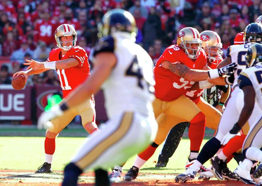 Quarterback Alex Smith (11) goes back into the game after suffering a concussion in the second quarter of the San Francisco 49ers game against the St. Louis Rams at Candlestick Park in San Francisco, Calif., on Sunday November 11, 2012. Photo: Brant Ward, The Chronicle / ONLINE_YES
