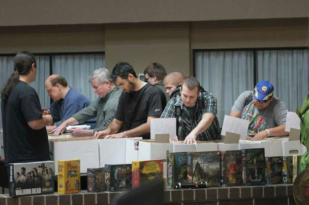Attendees look through bins of comics as they shop during the 5th annual Albany Comic Con on Sunday, Nov. 11, 2012 at the Holiday Inn in Albany, NY.  (Paul Buckowski / Times Union) Photo: Paul Buckowski  / 00020065A