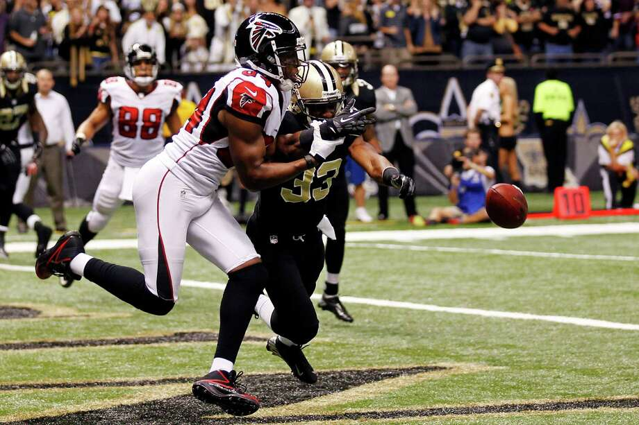 The Saints' Jabari Greer (33) breaks up a pass in the end zone intended for Atlanta's Roddy White on fourth-and-goal from the 1 late in Sunday's game at New Orleans. Photo: Bill Haber, FRE / FR170136 AP
