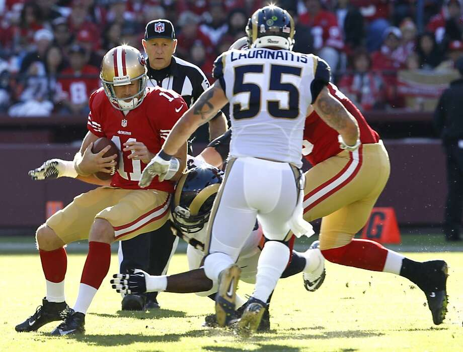 Alex Smith gets sacked by the Rams' Michael Brockers at the start of the second quarter. Smith finished the drive with a touchdown pass, then left the game with a concussion. Photo: Brant Ward, The Chronicle
