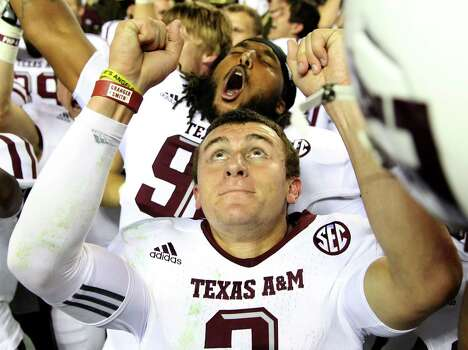Quarterback Johnny Manziel #2 of the Texas A&M Aggies celebrates after the game against the Alabama Crimson Tide at Bryant-Denny Stadium on November 10, 2012 in Tuscaloosa, Alabama.  The Aggies beat the Crimson Tide 29-24. Photo: Mike Zarrilli, Getty Images / 2012 Getty Images