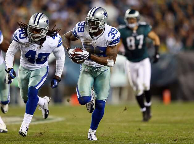 Brandon Carr #39 of the Dallas Cowboys recovers a fumble and runs it in for a touchdown as teammate  Danny McCray #40 blocks in the fourth quarter against the Philadelphia Eagles on November 11, 2012 at Lincoln Financial Field in Philadelphia, Pennsylvania.The Dallas Cowboys defeated the Philadelphia Eagles 38-23.  (Photo by Elsa/Getty Images) (Getty Images)