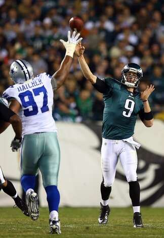 Nick Foles #9 of the Philadelphia Eagles passes under pressure from Jason Hatcher #97 of the Dallas Cowboys on November 11, 2012 at Lincoln Financial Field in Philadelphia, Pennsylvania.The Dallas Cowboys defeated the Philadelphia Eagles 38-23.  (Photo by Elsa/Getty Images) (Getty Images)
