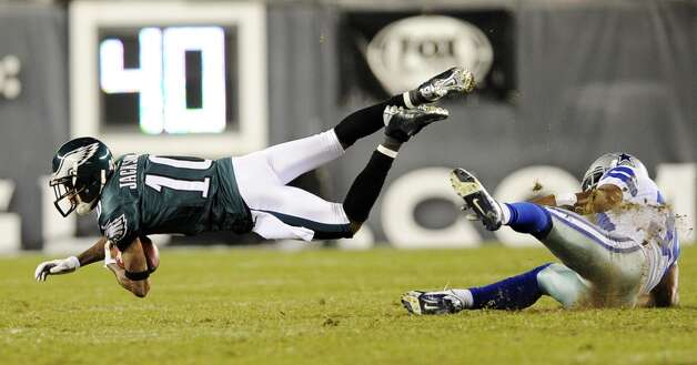 Philadelphia Eagles' DeSean Jackson, left, dives after being tackled by Dallas Cowboys' Brandon Carr in the second half of an NFL football game, Sunday, Nov. 11, 2012, in Philadelphia. (AP Photo/Michael Perez) (Associated Press)