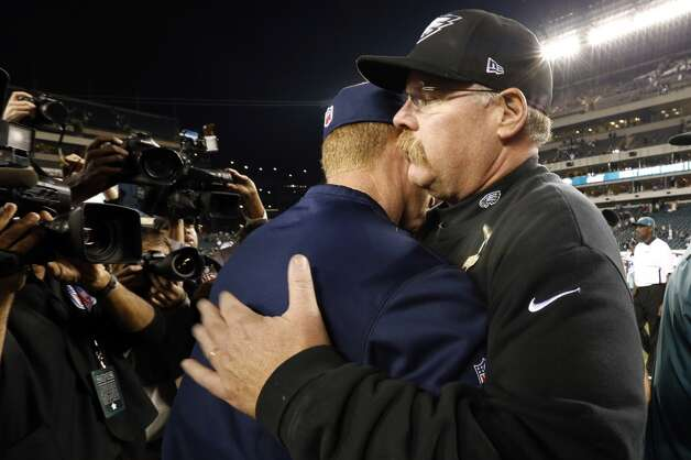 Philadelphia Eagles head coach Andy Reid, right, greets Dallas Cowboys head coach Jason Garrett after an NFL football game, Sunday, Nov. 11, 2012, in Philadelphia. Dallas won 38-23. (AP Photo/Julio Cortez) (Associated Press)