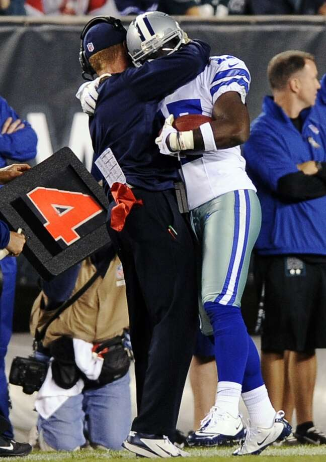 Dallas Cowboys head coach Jason Garrett, left, hugs Dwayne Harris after Harris returned a punt for a touchdown in the second half of an NFL football game against the Philadelphia Eagles, Sunday, Nov. 11, 2012, in Philadelphia. Dallas won 38-23. (AP Photo/Michael Perez) (Associated Press)