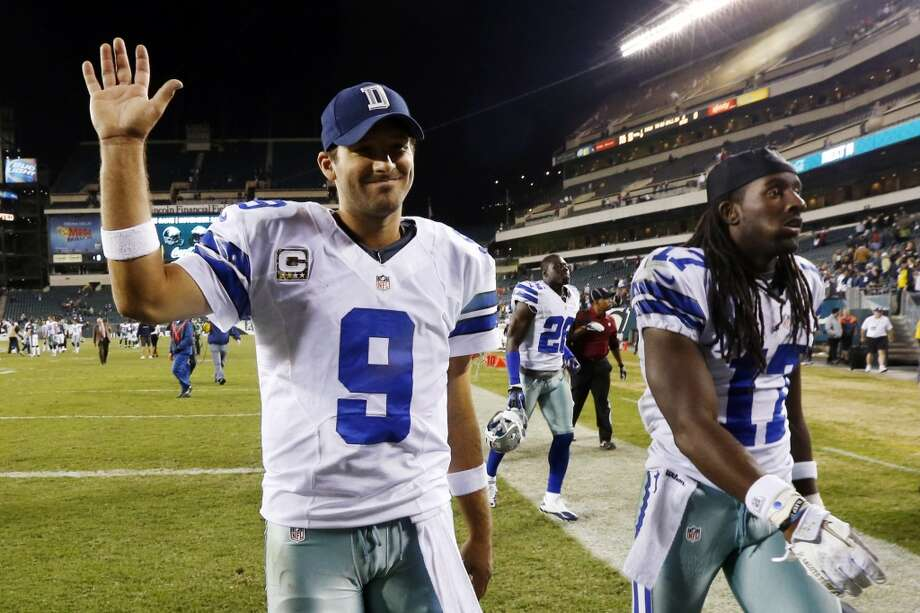 Dallas Cowboys quarterback Tony Romo, left, and wide receiver Dwayne Harris walk off the field after an NFL football game against the Philadelphia Eagles, Sunday, Nov. 11, 2012, in Philadelphia. Dallas won 38-23. (AP Photo/Julio Cortez) (Associated Press)