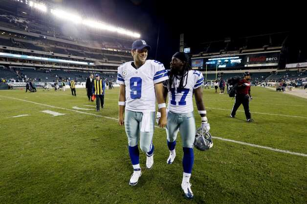 Dallas Cowboys' Tony Romo, left, and Dwayne Harris walks off the field after an NFL football game against the Philadelphia Eagles, Sunday, Nov. 11, 2012, in Philadelphia. Dallas won 38-23. (AP Photo/Julio Cortez) (Associated Press)