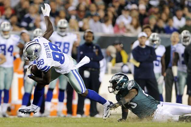 Dallas Cowboys' Dez Bryant, left, slips past Philadelphia Eagles' Dominique Rodgers-Cromartie in the second half of an NFL football game, Sunday, Nov. 11, 2012, in Philadelphia. (AP Photo/Michael Perez) (Associated Press)