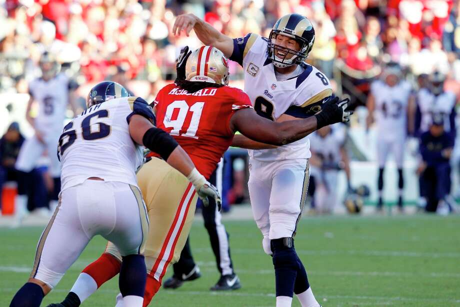San Francisco defensive tackle Ray McDonald (91) attempts to sack St. Louis Rams quarterback Sam Bradford (8) during the second half of the San Francisco 49ers game against the St. Louis Rams at Candlestick Park in San Francisco, Calif., on Sunday November 11, 2012. Photo: Brant Ward, The Chronicle / San Francisco Chronicle