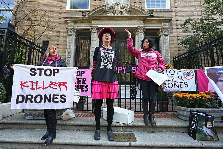 Code Pink's (from left) Medea Benjamin, Toby Blome and Nancy Mancias, outside Sen. Dianne Feinstein's home Sunday, protested the U.S. military's use of drones, which have killed a number of civilians. Photo: Rashad Sisemore, The Chronicle