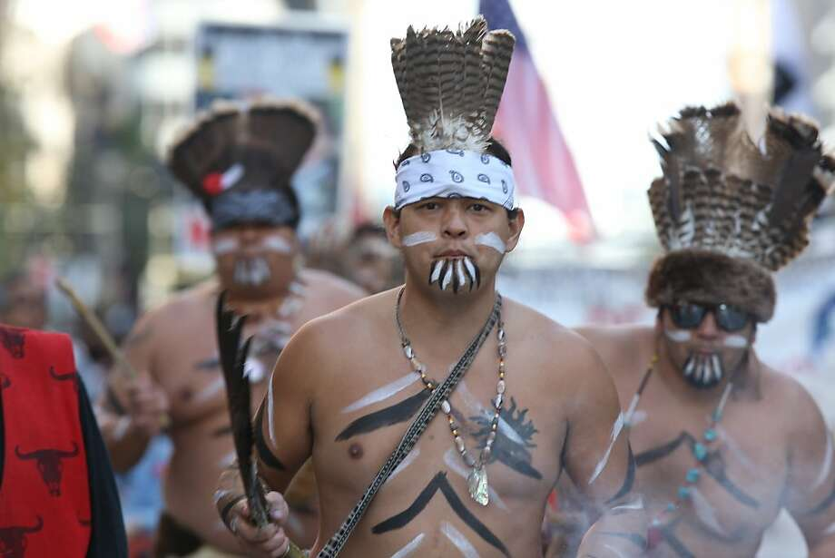 Daniel Quiroga, a member of the Muwekma Ohlone Tribe in San Francisco chants while walking along the Veterans Day Parade route on Market St. in San Francisco Calif. on Sunday, November 11, 2012. Photo: Alejandra Bayardo, The Chronicle