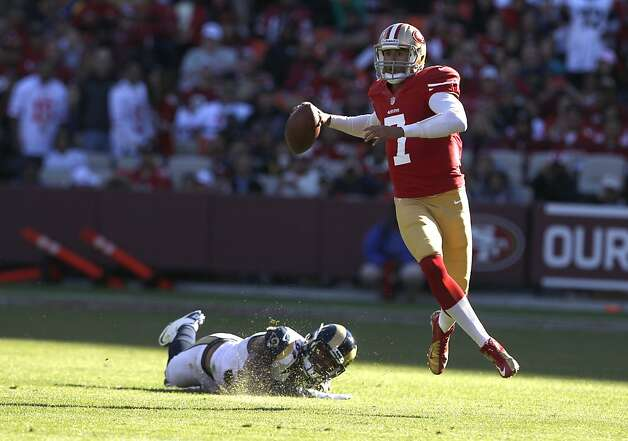 Quarterback Colin Kaepernick (7) escapes a tackle in the first half of the San Francisco 49ers game against the St. Louis Rams at Candlestick Park in San Francisco, Calif., on Sunday November 11, 2012. Photo: Carlos Avila Gonzalez, The Chronicle