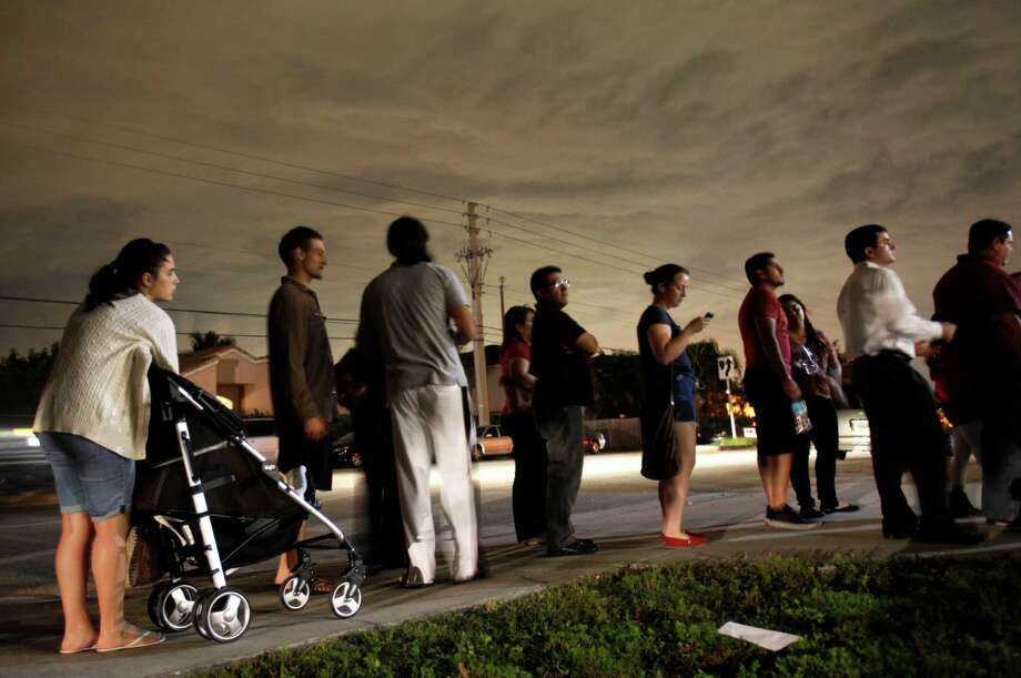 Demographics: Non-whites made up 28 percent of the voters this year, an increase that contributed to Obama's victory (line at Miami polling station).  Photo: Wilfredo Lee, Associated Press / AP