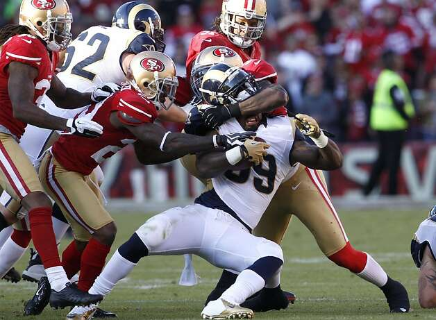 The Rams' Steven Jackson, who ran for 101 yards, is dragged down by multiple 49ers in the second half. Photo: Carlos Avila Gonzalez, The Chronicle