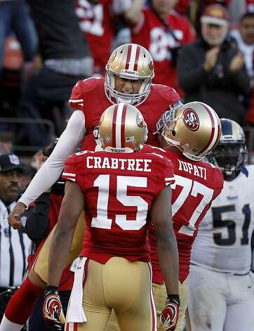 Colin Kaepernick celebrated his fourth quarter touchdown. The San Francisco 49ers and the Saint Louis Rams played to a 24-24 tie Sunday November 11, 2012. Photo: Brant Ward, The Chronicle