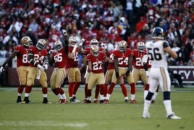 The 49ers' special-teams players get into the rhythm of the game with a little dancing before a fourth-quarter kickoff. Photo: Carlos Avila Gonzalez, The Chronicle