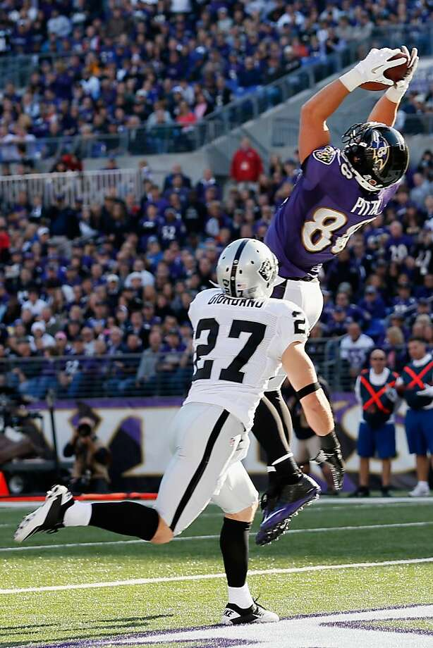 Ravens tight end Dennis Pitta makes a 5-yard touchdown catch over safety Matt Giordano. Photo: Rob Carr, Getty Images