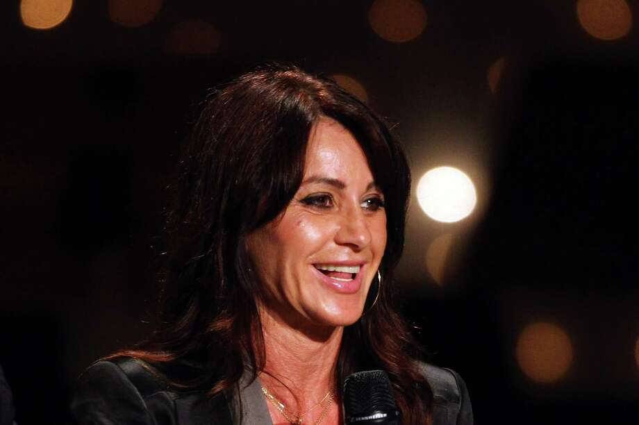 BADEN-BADEN, GERMANY - SEPTEMBER 28:  (FILE PHOTO) Romanian Gymnast Nadia Comaneci Turns 51. Nadia Comaneci, five time Olympic champion in acrobatics, attends the DOSB celebrations to 30 years Olympic Congress on September 28, 2011 in Baden-Baden, Germany.  (Photo by Dennis Grombkowski/Bongarts/Getty Images) Photo: Dennis Grombkowski / 2011 Getty Images