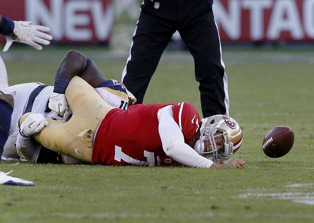Colin Kaepernick hit the ground after being caught by linebacker Mario Haggan in the fourth quarter. The San Francisco 49ers and the Saint Louis Rams played to a 24-24 tie Sunday November 11, 2012. Photo: Brant Ward, The Chronicle