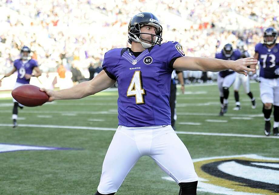 Punter Sam Koch is no longer pointless. He scored on fake field goal to put the Ravens up 48-17. Photo: Nick Wass, Associated Press