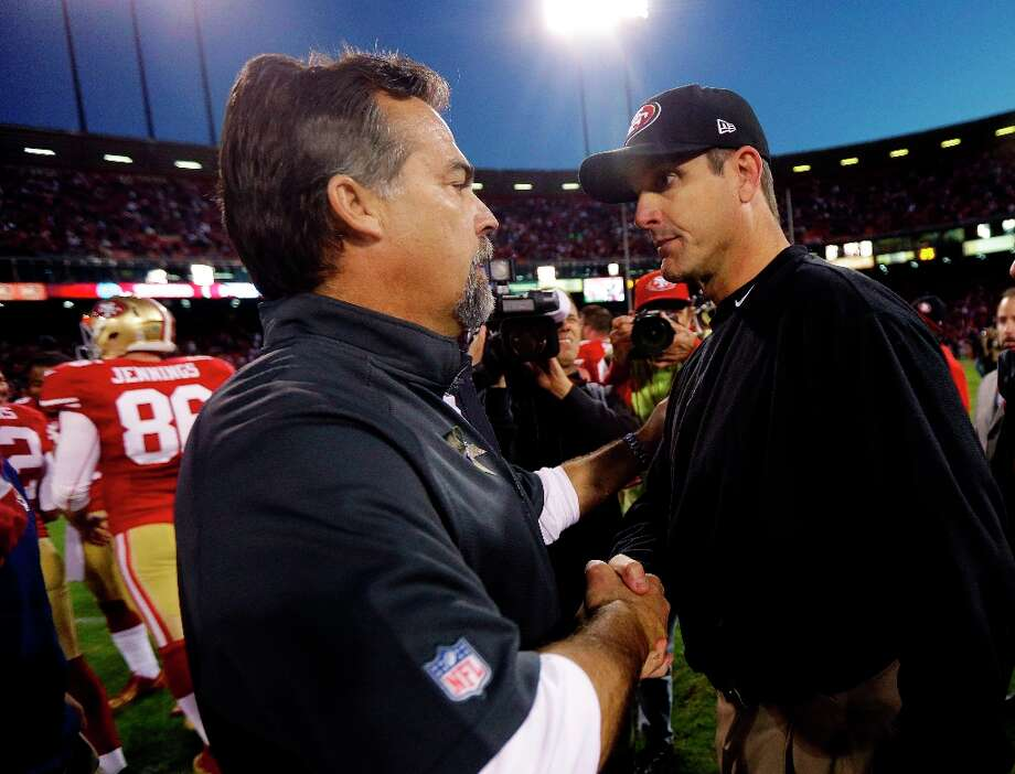 St. Louis Rams head coach Jeff Fisher, left, shakes hands with San Francisco 49ers head coach Jim Harbaugh at the end of their NFL football game in San Francisco, Sunday, Nov. 11, 2012. San Francisco and St. Louis tied their game 24-24. Photo: Marcio Jose Sanchez, Associated Press / AP