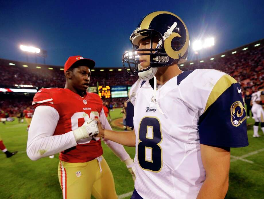 St. Louis Rams quarterback Sam Bradford, right, is greeted by San Francisco 49ers outside linebacker Aldon Smith, left, at the end of their NFL football game in San Francisco, Sunday, Nov. 11, 2012. San Francisco and St. Louis tied their game 24-24. Photo: Marcio Jose Sanchez, Associated Press / AP
