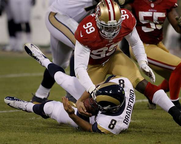 Aldon Smith sacked Sam Bradford during the overtime period. The San Francisco 49ers and the Saint Louis Rams played to a 24-24 tie Sunday November 11, 2012. Photo: Brant Ward, The Chronicle