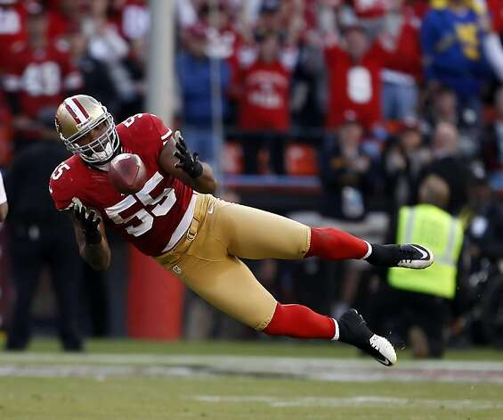 Ahmad Brooks tries to catch the ball after he broke up a pass by Sam Bradford in the overtime period. The San Francisco 49ers played the St. Louis Rams at Candlestick Park in San Francisco, Calif., on Sunday, November 11, 2012. The teams played to a tie in overtime. Photo: Carlos Avila Gonzalez, The Chronicle