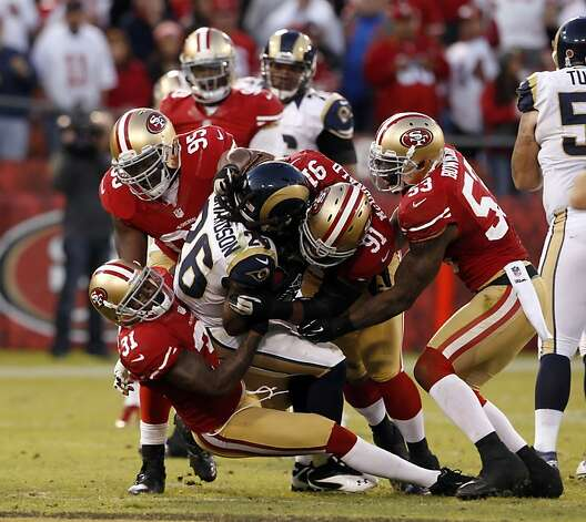 The 49ers defense holds Daryl Richardson in the overtime period. The San Francisco 49ers played the St. Louis Rams at Candlestick Park in San Francisco, Calif., on Sunday, November 11, 2012. The teams played to a tie in overtime. Photo: Carlos Avila Gonzalez, The Chronicle