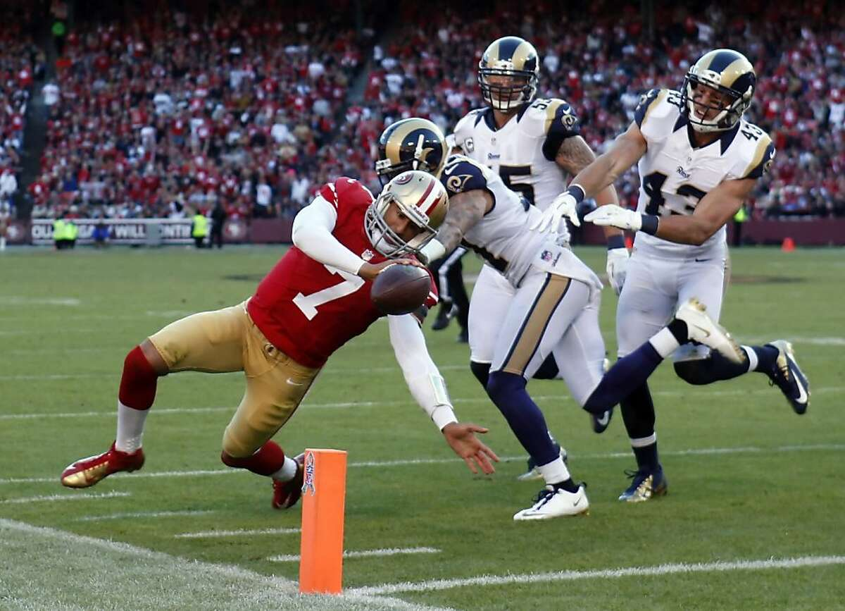 Colin Kaepernick runs in a touchdown in the fourth quarter. The San Francisco 49ers played the St. Louis Rams at Candlestick Park in San Francisco, Calif., on Sunday, November 11, 2012. The teams played to a tie in overtime.
