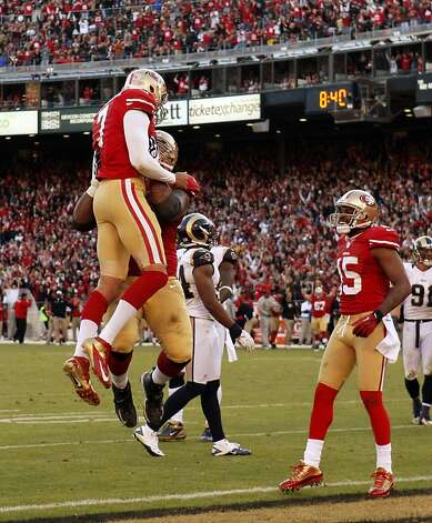 Mike Iupati lifts Colin Kaepernick in the end zone after Kaepernick scored in the fourth quarter. The San Francisco 49ers played the St. Louis Rams at Candlestick Park in San Francisco, Calif., on Sunday, November 11, 2012. The teams played to a tie in overtime. Photo: Carlos Avila Gonzalez, The Chronicle