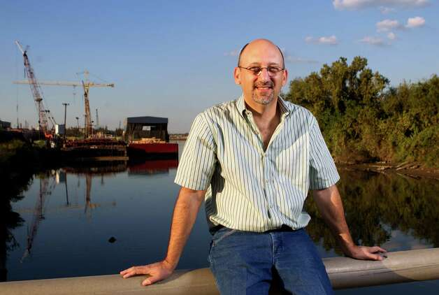 Alex Cuclis sits on a bridge overlooking the Houston Ship Channel where barges enter and exit Thursday, Nov. 1, 2012, in Houston. (Cody Duty / Houston Chronicle) Photo: Cody Duty, Staff / © 2012 Houston Chronicle