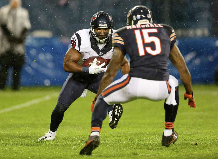 Free safety Danieal Manning #38 of the Houston Texans carries the ball against wide receiver Brandon Marshall #15 of the Chicago Bears during the game at Soldier Field on November 11, 2012 in Chicago, Illinois. Photo: Jonathan Daniel, Getty Images / 2012 Getty Images