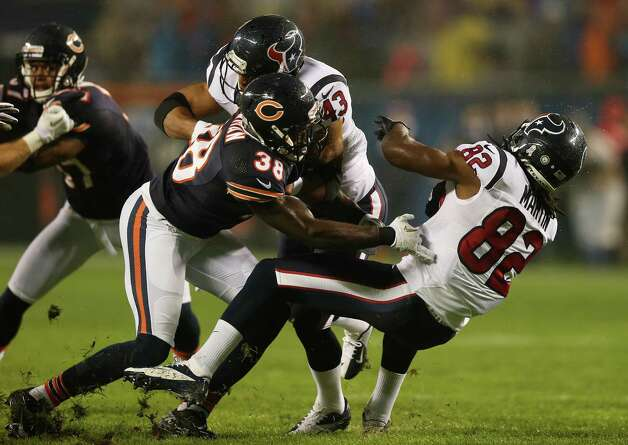 Wide receiver Keshawn Martin #82 of the Houston Texans is tackled by defensive back Zack Bowman #38 of the Chicago Bears in the first quarter of the game at Soldier Field on November 11, 2012 in Chicago, Illinois. Photo: Jonathan Daniel, Getty Images / 2012 Getty Images