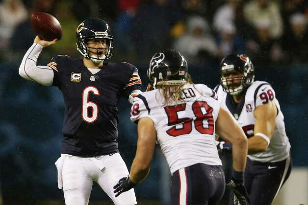Quarterback Jay Cutler #6 of the Chicago Bears looks to pass over outside linebacker Brooks Reed #58 of the Houston Texans in the first quarter of the game at Soldier Field on November 11, 2012 in Chicago, Illinois. Photo: Jonathan Daniel, Getty Images / 2012 Getty Images