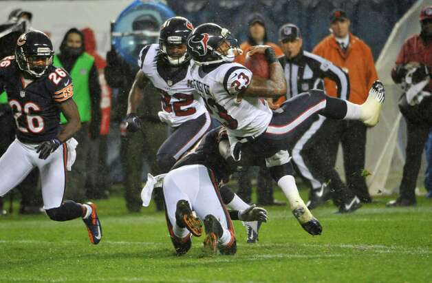 Arian Foster #23 of the Houston Texans is tackled by Major Wright #21 of the Chicago Bearson November 11, 2012 at Soldier Field in Chicago, Illinois. Photo: David Banks, Getty Images / 2012 Getty Images