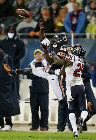 Wide receiver Devin Hester #23 of the Chicago Bears fails to catch a pass as cornerback Kareem Jackson #25 of the Houston Texans defends in the second quarter of the game at Soldier Field on November 11, 2012 in Chicago, Illinois. Photo: Jonathan Daniel, Getty Images / 2012 Getty Images