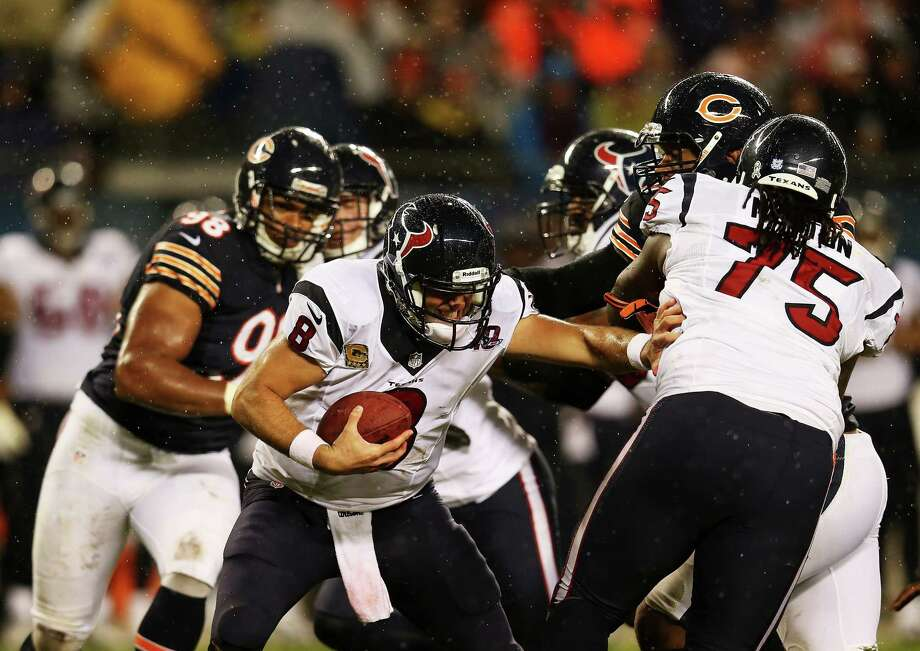 Quarterback Matt Schaub #8 looks for cover behind tackle Derek Newton #75 of the Houston Texans during the game against the Chicago Bears at Soldier Field on November 11, 2012 in Chicago, Illinois. Photo: Jonathan Daniel, Getty Images / 2012 Getty Images